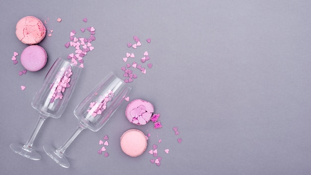 Flat lay of glasses with heart-shaped confetti