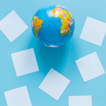 Flat lay of globe with paper