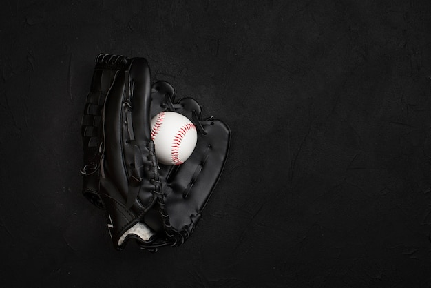 Flat lay of glove with ball inside