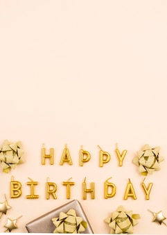 Flat lay golden birthday decorations frame