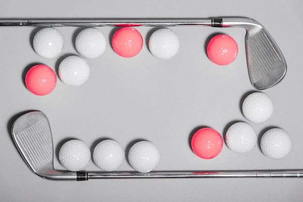 Flat lay golf balls frame with golf club