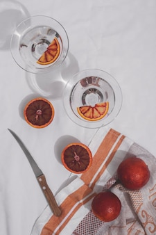 Flat lay grapefruits and knife arrangement