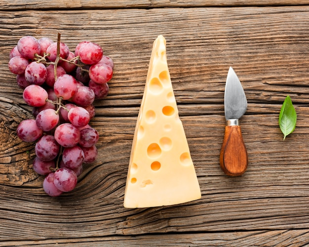 Flat lay grapes emmental and cheese knife