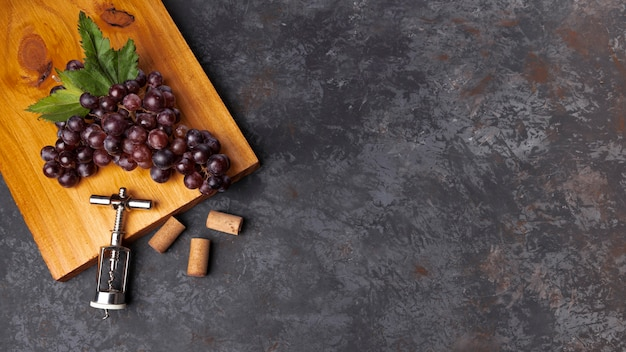 Flat lay grapes on wooden board with copy space