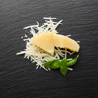 Flat lay grated parmesan on black background