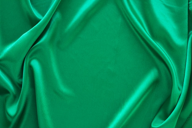 Flat lay of green fabric for carnival