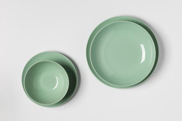 Flat lay green plates arrangement