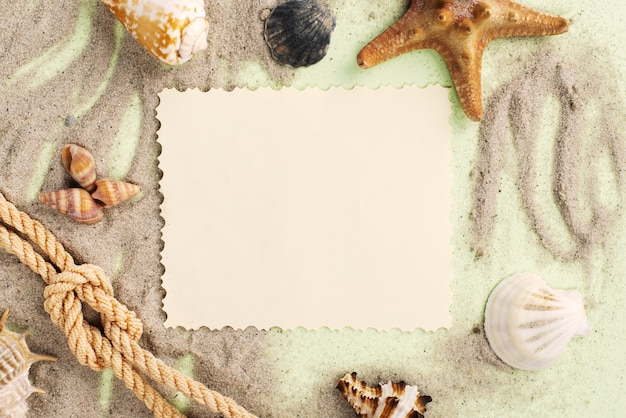 Flat lay greeting card in sand