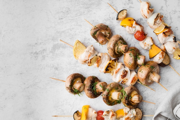 Flat lay grilled chicken and vegetables skewers