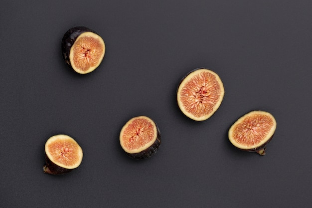 Flat lay of half sliced figs