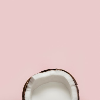 Flat lay halved coconut fruit
