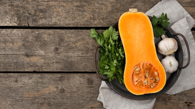 Flat lay halved pumpkin composition with copy space