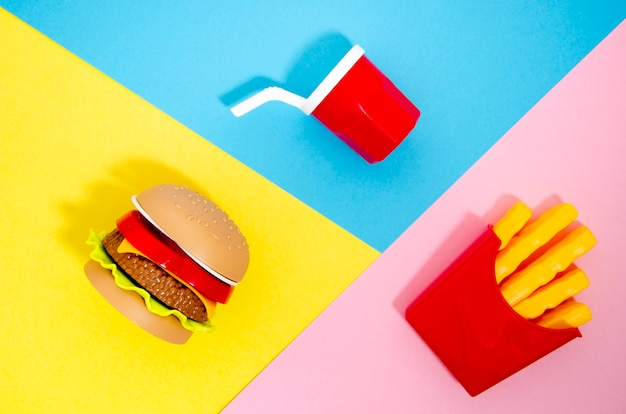 Flat lay of hamburger and fries replicas