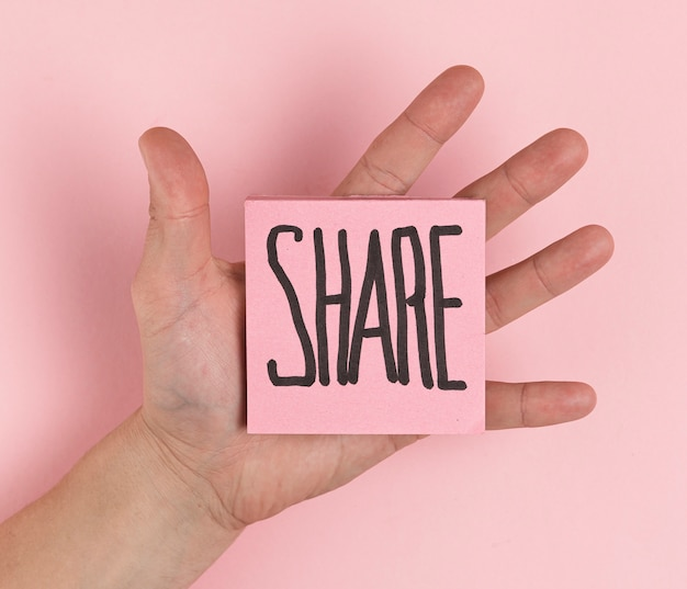 Flat lay hand holding sticky notes