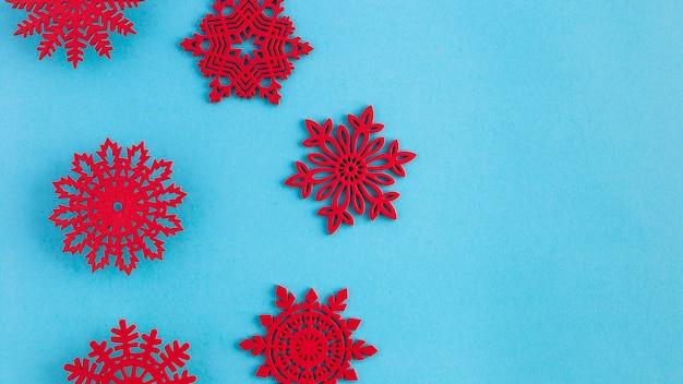 Flat lay handmade red snowflakes