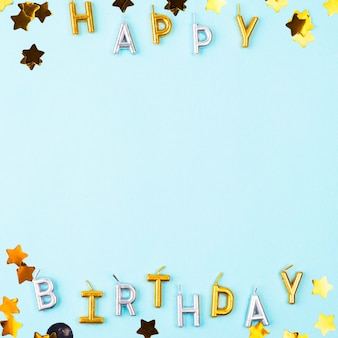 Flat lay happy birthday candles frame