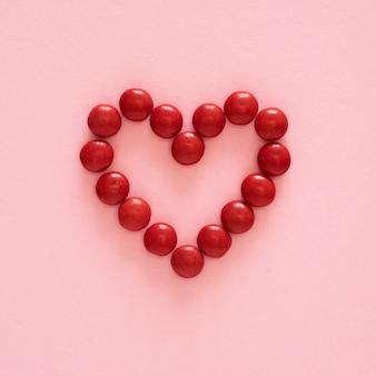 Flat lay heart shape candy arrangement