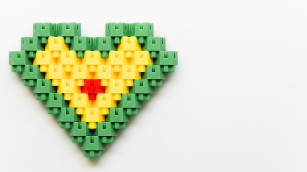 Flat lay heart shape made of lego blocks