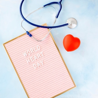 Flat lay of heart shape with frame and stethoscope