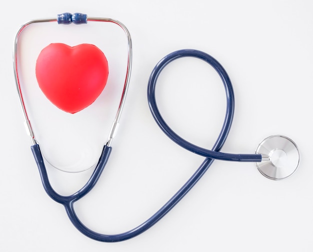 Flat lay of heart shape with stethoscope
