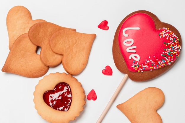 Flat lay of heart-shaped cookie on stick