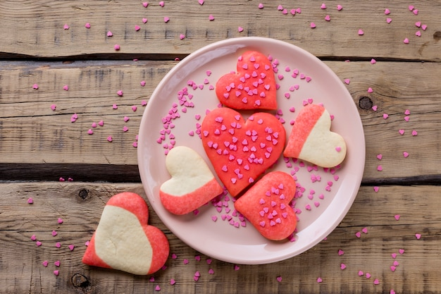 Flat lay of heart-shaped cookies on plate