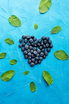 Flat-lay heartshaped currants with leaves
