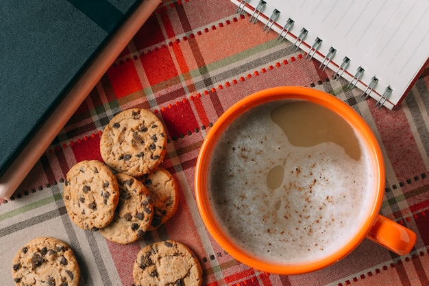 Flat lay of hot chocolate on cashmere background