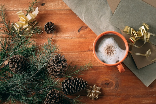 Flat lay of hot chocolate on wooden background