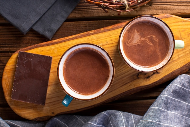 Flat lay hot chocolates with chocolate tablet