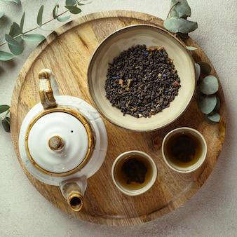 Flat lay hot tea and herbs arrangement