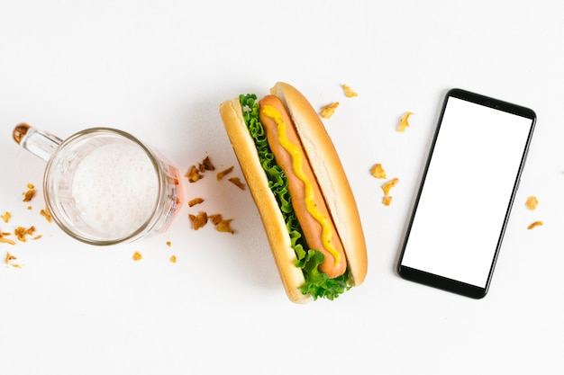 Flat lay hotdog with smartphone mock-up