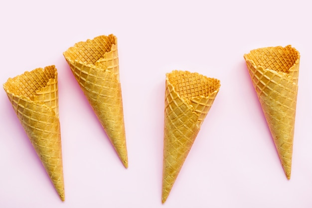 Flat lay ice cream cones collection on pink  background .