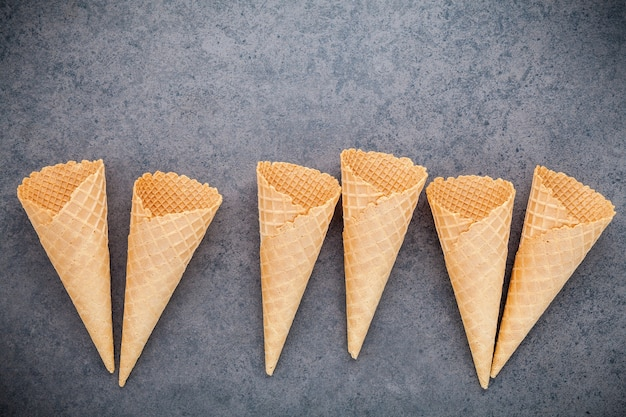 Flat lay ice cream cones collection on stone background for sweets menu design.