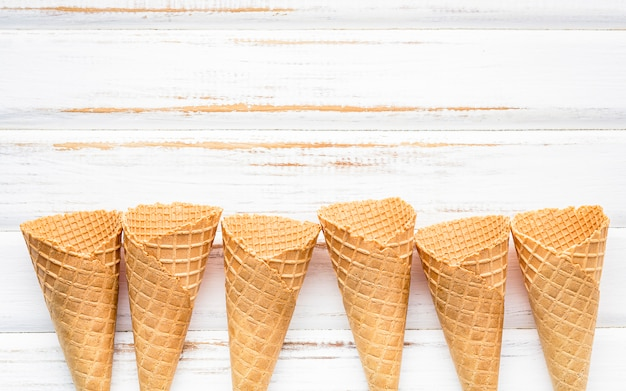 Flat lay ice cream cones collection .
