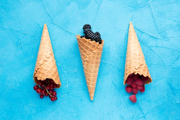 Flat-lay ice cream cones with berries