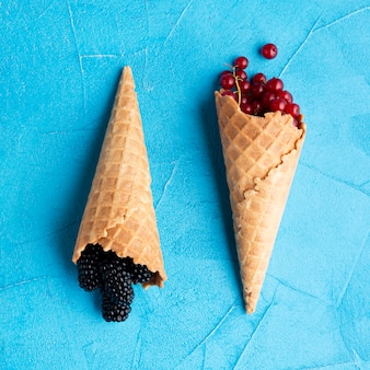 Flat-lay ice cream cones with berries