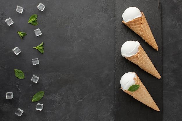 Flat lay ice cream on cones with ice cubes