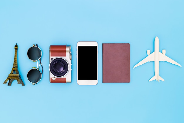 Flat lay image of accessory clothing to plan travel in holiday on blue