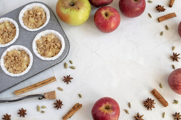 Flat lay of inredients for apple pie or muffins, autumn bakery.