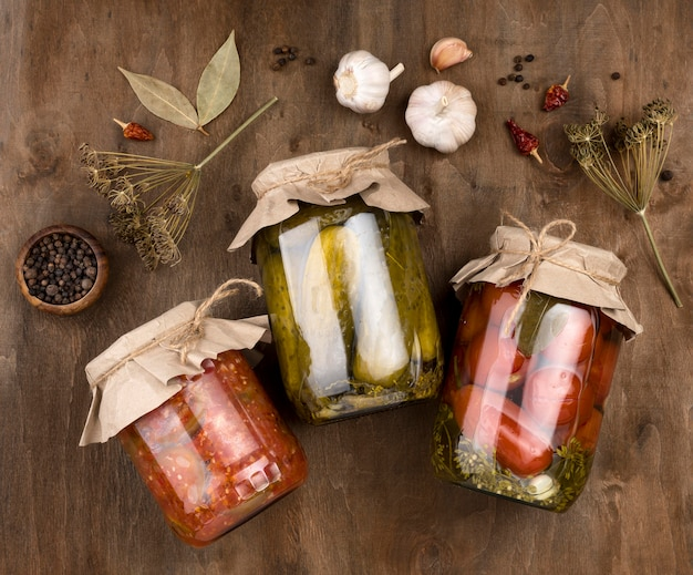 Flat lay jars with preserved vegetables