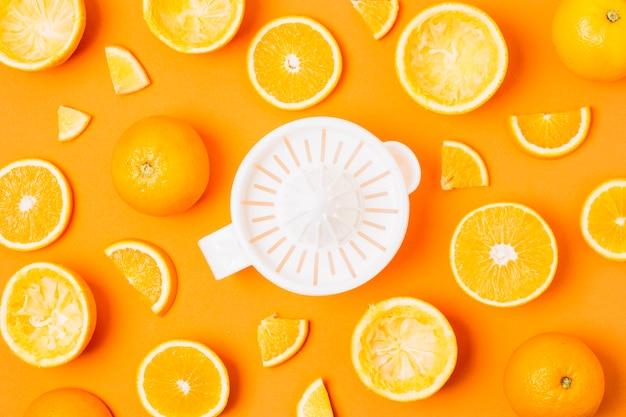 Flat lay juicer with arrangement of oranges