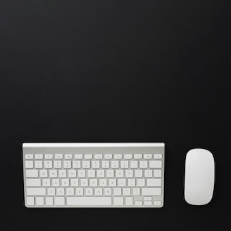 Flat lay of keyboard and mouse on desktop