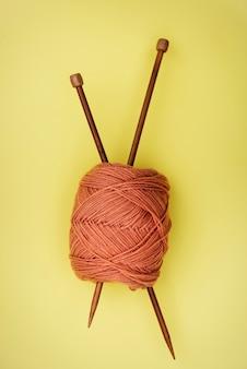 Flat lay of knitting needle and yarn