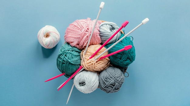 Flat lay knitting needles and wool in basket