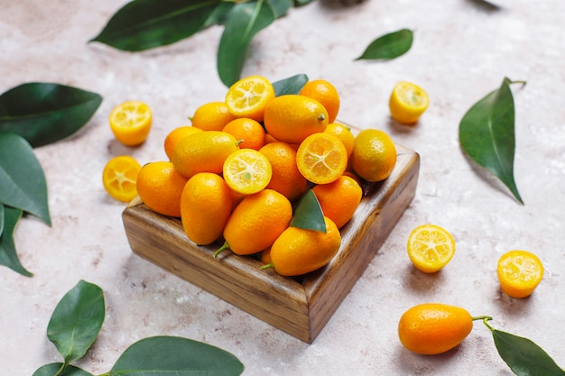 Flat lay of kumquats on a concrete surface