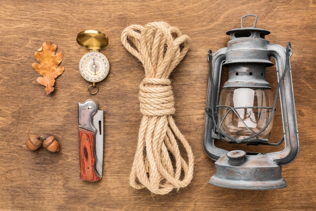 Flat lay of lantern with rope and autumn leaves