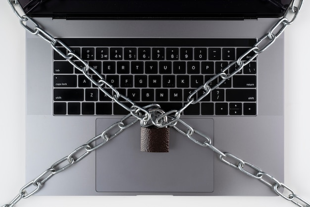 Flat lay laptop with lock and chain