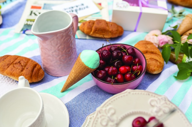 Flat lay layout with cherries and ice cream in waffle cones