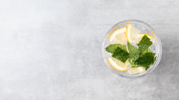Flat lay of lemonade on wooden background with copy space